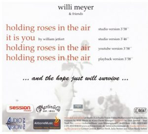 Willi_Meyer_holding_roses_in_the-air_(2)